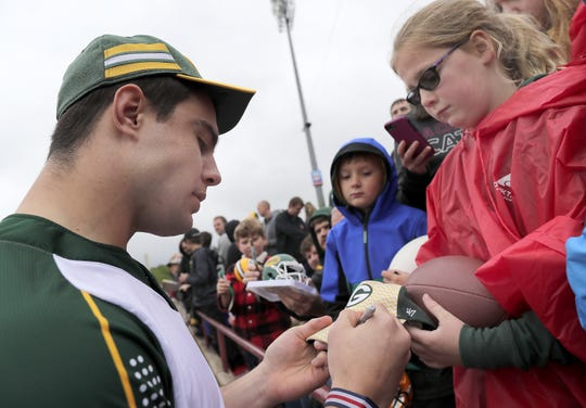 Green Bay Packers' #50 Blake Martinez signs an autograph during the Green & Gold Charity Softball Game on Saturday, June 1, 2019, at Neuroscience Group Field at Fox Cities Stadium in Grand Chute, Wis. The event is a fundraiser for Feeding America Eastern Wisconsin, Make-A-Wish Wisconsin and various youth sports organizations