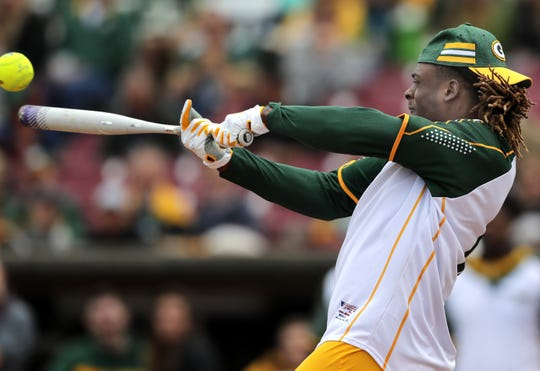 Green Bay Packers' #17 Davante Adams bats during the Green & Gold Charity Softball Game on Saturday, June 1, 2019, at Neuroscience Group Field at Fox Cities Stadium in Grand Chute, Wis. The event is a fundraiser for Feeding America Eastern Wisconsin, Make-A-Wish Wisconsin and various youth sports organizations