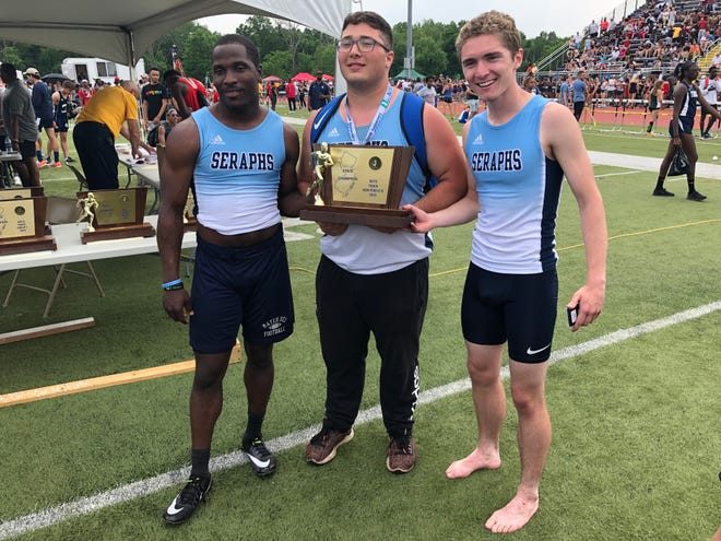 The seniors on the Mater Dei Prep boys track team take a moment with the trophy after the Seraphs won the NJSIAA Non-Public B title on June 1, 2019 at Franklin High School