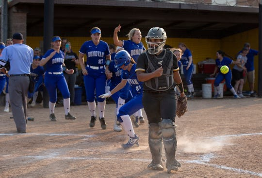 St John Vianney catcher Ally Jones walks towards the dugout as Donovan Catholic celebrate game winning walk in the 10th inning.Donovan Catholic Girls Softball defeats St. John Vianney in a 10 inning Non-Public A Softball Final at Rowan University in Pitman, NJ on 5/31/19.