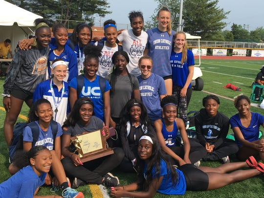 Union Catholic's girls track team poses with the Non-Public A trophy