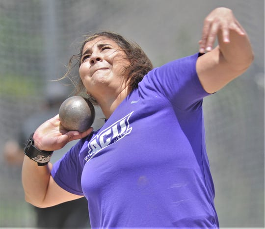 ACU's Kayla Melgar throws the shot put during practice Thursday, May 30, 2019, at the school's throwing area. Melgar, a senior from Tempe, Ariz., will compete at the Division I track and field meet Thursday in Austin.