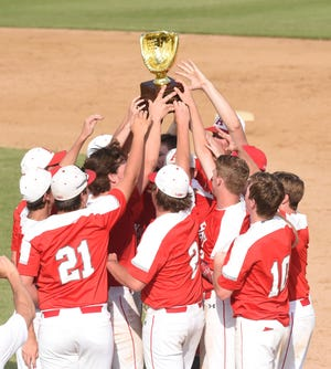 The Albany baseball team raises the Region I-2A championship trophy after its 4-3, walk-off win in Game 3 against New Deal at Moffett Field in Snyder on Friday. Albany came back after losing Game 1 to sweep Friday's games and return to the state tournament for the second time in three years.
