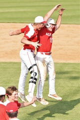 Albany's Ryan Hill, left, and Josh Dyer celebrate Friday's 4-3 walk-off win in Game 3 of the Region I-2A final against New Deal. With the win, Albany returns to the state tournament for the second time in three years.