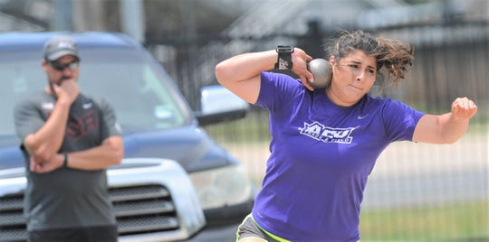 ACU's Kayla Melgar, right, gets ready to throw the shot put while throws coach Jerrod Cooks looks on during practice Thursday, May 30, 2019, at ACU's throwing area. Melgar, a senior from Tempe, Ariz., will join teammate Annina Brandenburg at the Division I track and field meet, which begins Wednesday in Austin.