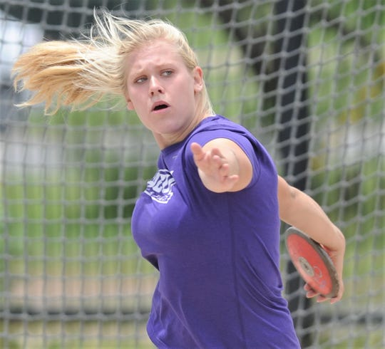 ACU's Annina Brandenburg gets ready to throw the discus during practice Thursday, May 30, 2019, at ACU's throwing area. Brandenburg, a sophomore from Dusseldorf, Germany, will compete at the NCAA Division I track and field meet Saturday in Austin.