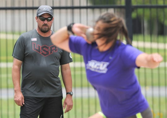 ACU throws coach Jerrod Cook, left, watches senior Kayla Melgar throw the shot put during practice Thursday, May 30, 2019, at ACU's throwing area. Melgar and teammate Annina Brandenburg will compete at the NCAA Division I track and field meet, which begins Wednesday in Austin.