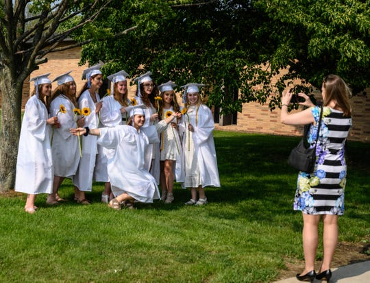 Harper Creek students pose for the camera prior to the  2019 graduation ceremony on Friday.