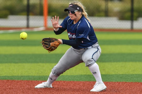 Jessica Warren of the USSSA Pride fields a grounder during Friday's exhibition game against the Czech National Team.