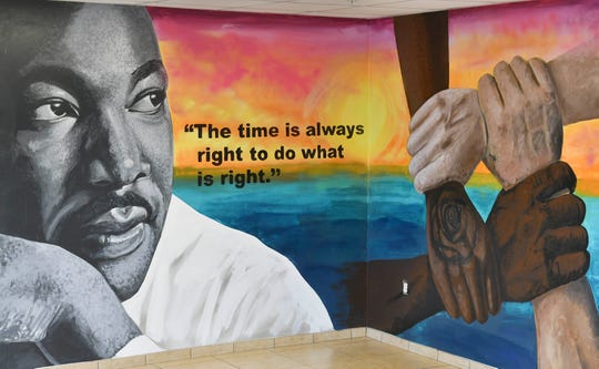 Artist Christopher Maslow painted this mural on the wall at Daily Bread in Melbourne. The mural was dedicated in a brief ceremony Saturday.