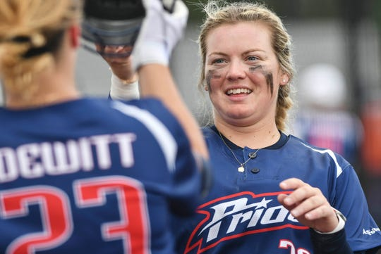 Former FSU star Jessica Warren of the USSSA Pride high fives teammate Nicole DeWitt after hitting a home run during Friday's exhibition game against the Czech National Team.