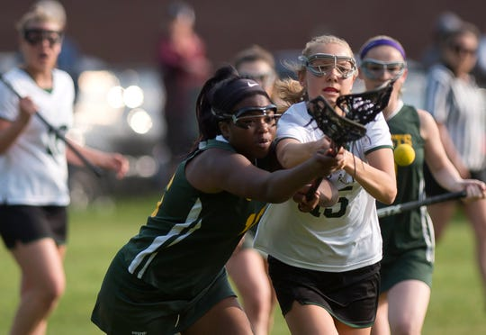 BFA-St. Albans' Mindy St. Marie, left, and Rice's Hadley Murphy fight for a ground ball during Friday's Division I high school girls lacrosse quarterfinal in South Burlington on May 31, 2019.