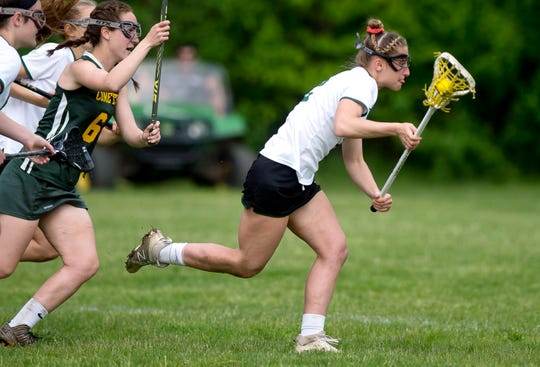 Rice's Lisa McNamara, right, breaks free after scooping up a ground ball against BFA-St. Albans during Friday's Division I high school girls lacrosse quarterfinal in South Burlington on May 31, 2019.