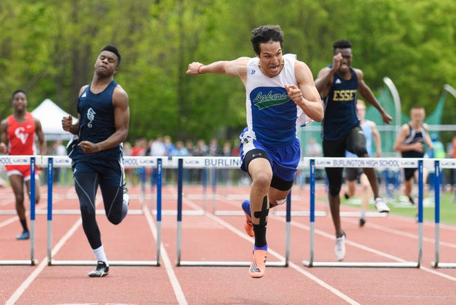 Colchester's George Cummings leads the pack in the boys 300m hurdles during the high school track and field championships at D.G. Weaver Athletic Complex on Saturday June 1, 2019 in Burlington, Vermont.