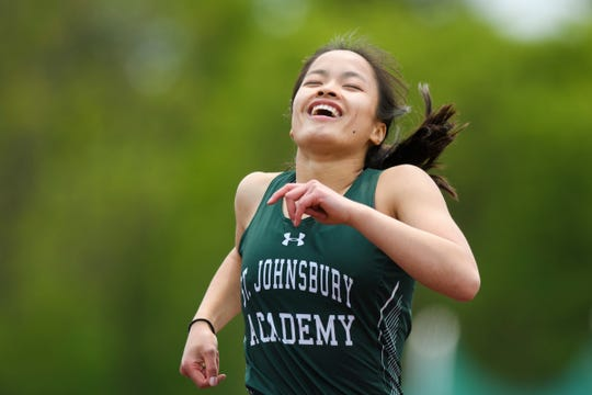 St. Johnsbury's Jen Rotti smiles as she crosses the finish line in the girls 300m hurdles during the high school track and field championships at D.G. Weaver Athletic Complex on Saturday June 1, 2019 in Burlington, Vermont.