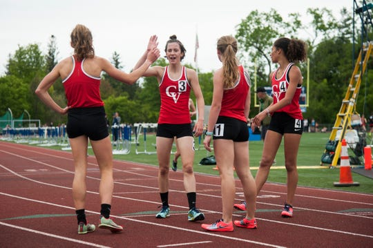 CVU celebrates the top five finishes of the girls 1500m race during the high school track and field championships at D.G. Weaver Athletic Complex on Saturday June 1, 2019 in Burlington, Vermont.