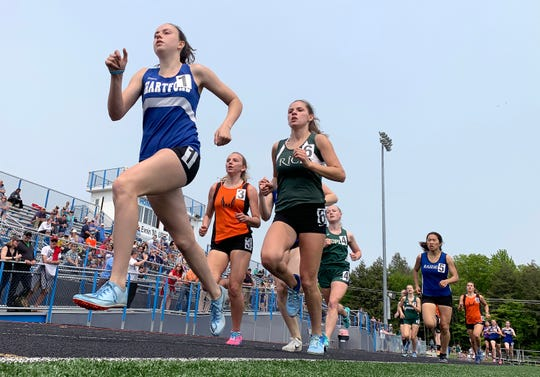 Hartford's Kennedy Mullen, left, leads the pack in the girls 800 meters during the Division II state championship meet at South Burlington High School on Saturday, June 1, 2019.