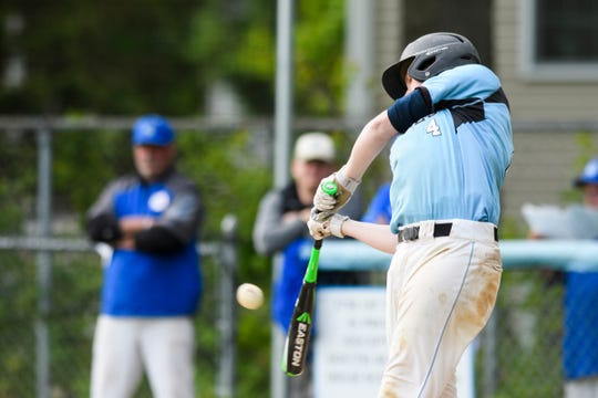 South Burlington's Mason Klesch (4) hits the ball during the baseball quarterfinal game between the Colchester Lakers and the South Burlington Wolves at South Burlington High School on Friday afternoon May 31, 2019 in South Burlington, Vermont.  (BRIAN JENKINS/for the FREE PRESS)