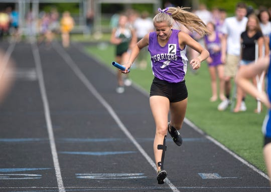 Bellows Falls' Jasmine Boucher crosses the finish line in the 4x400-meter relay to clinch the title for the Terriers during the Division II state championship meet at South Burlington High School on Saturday, June 1, 2019.