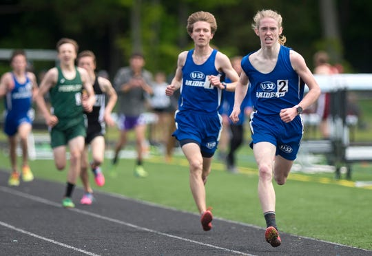 U-32's Waylon Kurts, right, runs the first lap of the boys 800 meters during the Division II state championship meet at South Burlington High School on Saturday, June 1, 2019.
