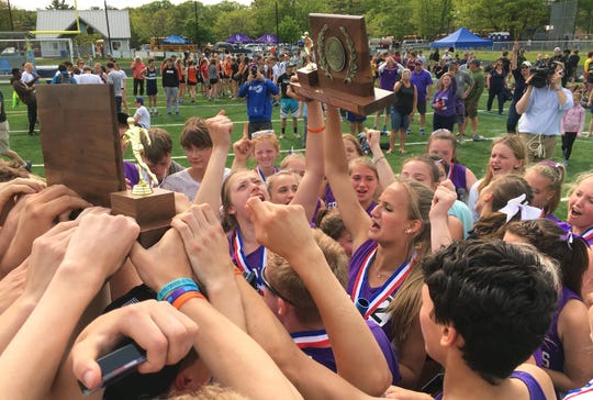 The Bellows Falls boys and girls track and field teams celebate their Division II state championships at South Burlington High School on Saturday, June 1, 2019.