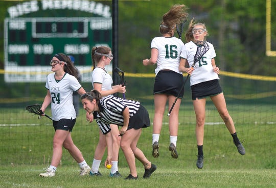 Rice's Hadley Murphy, right, celebrates a goal with Kate Buckley (16) and teammates during Friday's Division I high school girls lacrosse quarterfinal in South Burlington on May 31, 2019.