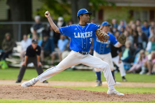 Colchester's Saul Minaya (3)delivers a pitch during the baseball quarterfinal game between the Colchester Lakers and the South Burlington Wolves at South Burlington High School on Friday afternoon May 31, 2019 in South Burlington, Vermont.  (BRIAN JENKINS/for the FREE PRESS)