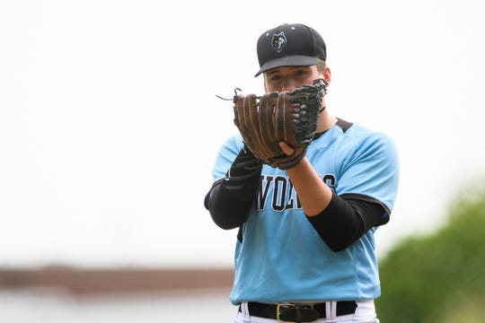 South Burlington pitcher Jack Ambrosino (5) looks at the catcher during the baseball quarterfinal game between the Colchester Lakers and the South Burlington Wolves at South Burlington High School on Friday afternoon May 31, 2019 in South Burlington, Vermont.  (BRIAN JENKINS/for the FREE PRESS)