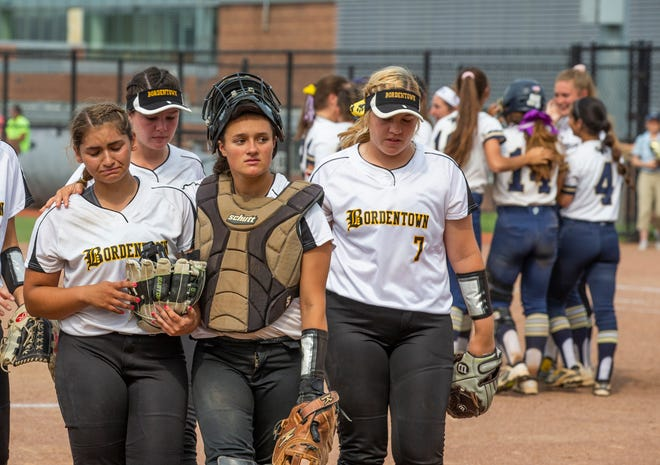 Bordetown players try to hide their disappointment aft losing in State Group 2 Softball final. Ramsey defeats Bordentown 2-1 with seventh inning run for NJSIAA Group 2 Softball Title in Union, NJ on June 1, 2019.