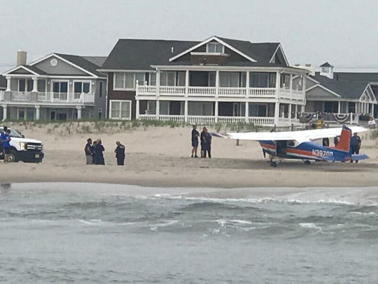 A single-engine Cessna sits on a strip of beach in Ocean City on Saturday morning.