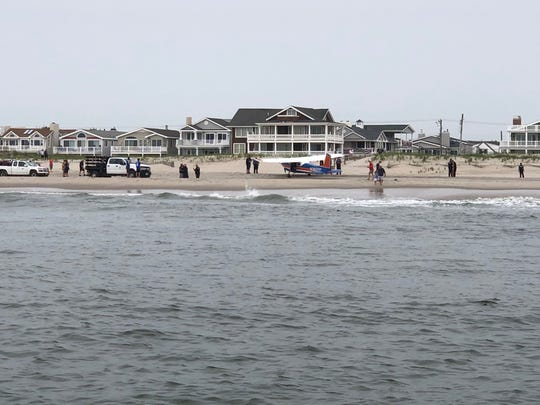 A small plane sits on an Ocean City beach after an emergency landing Saturday morning.