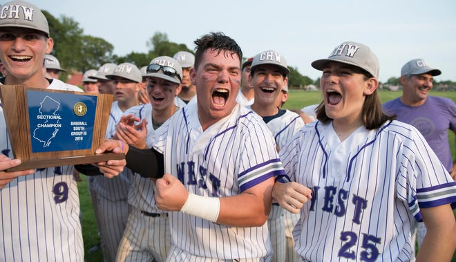 Cherry Hill West's, (front l-r), Scott Shaw, Nick Sylvester, and Frank Ebling celebrate with teammates after Cherry Hill West defeated Triton, 6-3, in the South Jersey Group 3 baseball final played at Triton High School in Runnemede on Friday, May 31, 2019.