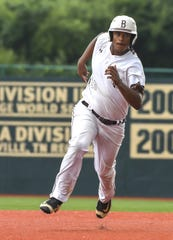 Tyler Bullock of Roger Bacon advances to third base against Versailles in the OHSAA DIII Regional Final at Wright State University, Friday, May 31, 2019