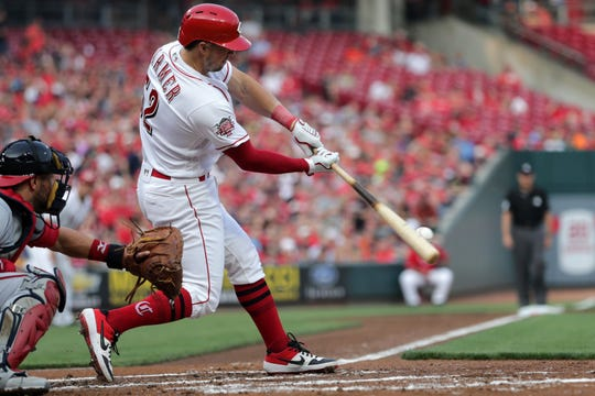 Kyle Farmer made his Reds' debut at catcher Tuesday night in a 5-4 win over Milwaukee.