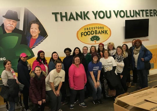 Ensemble Health workers volunteering at the Freestore/Foodbank