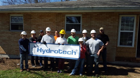 Workers at Hydrotech volunteering