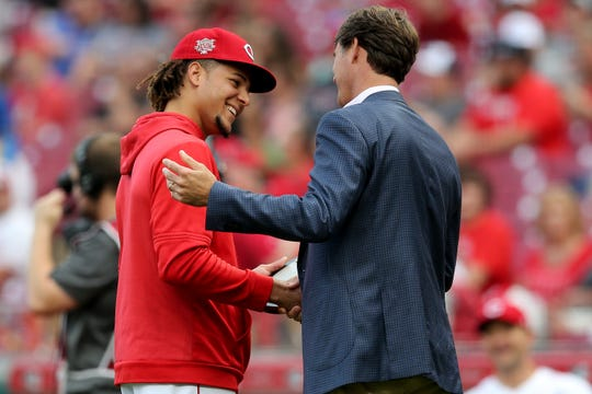 Cincinnati Reds starting pitcher Luis Castillo (58) is awarded the pitcher of the month award by Cincinnati Reds President of Baseball Operations Dick Williams before the the first inning of an MLB baseball game between the Washington Nationals and the Cincinnati Reds, Friday, May 31, 2019, at Great American Ball Park in Cincinnati.