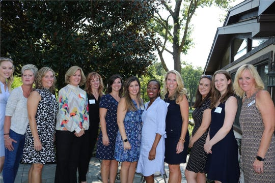 DBL Law workers enjoying an afternoon with our region's professional women at the firm's Signature Women's Event