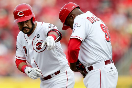 Cincinnati Reds third baseman Eugenio Suarez (7) gestures toward the dugout after hitting an RBI single in the first inning of an MLB baseball game against the Washington Nationals, Friday, May 31, 2019, at Great American Ball Park in Cincinnati.
