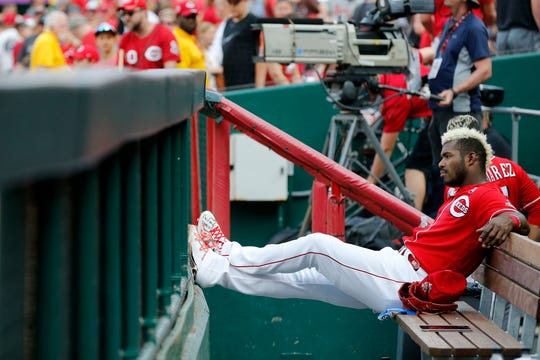 Cincinnati Reds right fielder Yasiel Puig (66) remains seated after the end of the ninth inning of the MLB National League game between the Cincinnati Reds and the Washington Nationals at Great American Ball Park in downtown Cincinnati on Saturday, June 1, 2019. The Reds lost 5-2.