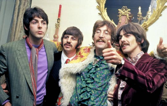 Paul McCartney, left, Ringo Starr, John Lennon and George Harrison celebrate the release of 'Sgt. Pepper's Lonely Hearts Club Band' in 1967.