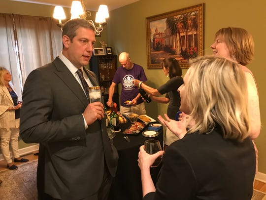 Democratic presidential hopeful U.S. Rep. Tim Ryan of Ohio speaks with Andrea Phillips,  vice chair of the Iowa Democratic Party, at a house party in Des Moines on Friday, May 31, 2019.