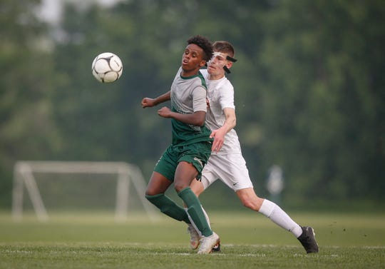 Iowa City West sophomore Marko Migambi, left, battles Ankeny freshman Conor Walhberg for the ball during the first round of the Class 3A Iowa boys state soccer tournament at Cownie Soccer Complex in Des Moines on Friday, May 31, 2019.