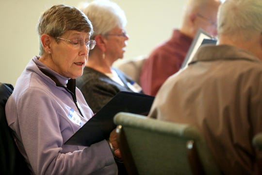 In a Tuesday, May 21, 2019 photo, Marilyn Dansart, of Dubuque, sings during a rehearsal for Healing Harmonies Chorus at Arbor Oaks Bible Chapel in Dubuque, Iowa. (Jessica Reilly/Telegraph Herald via AP)