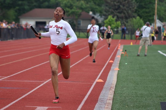 Oak Park's Chloe Vines finishes the final race, the 4x400 relay, just ahead of Detroit Renaissance anchor Leeah Burr, clinching Oak Park's fifth state championship in six seasons during the Division 1 track and field state finals on Saturday, June 1, 2019, at East Kentwood.