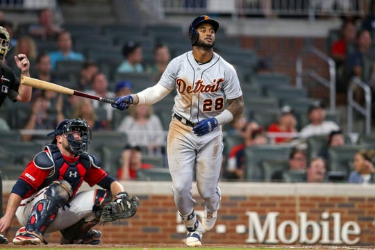 Shortstop Niko Goodrum hits a home run against the Braves in the eighth inning at SunTrust Park on Friday.