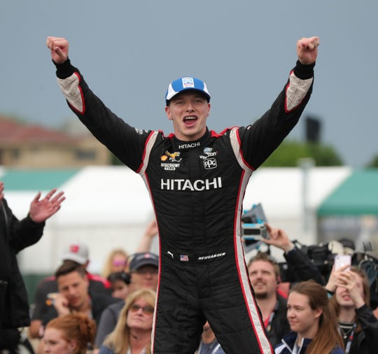 Josef Newgarden celebrates his victory in the Detroit Grand Prix, Saturday on Belle Isle.