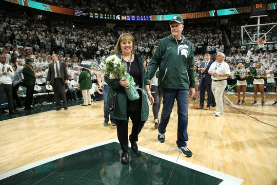 Lori Soderberg walks with her husband, Sam, to be honored after the Spartans' senior night win over Michigan on March 9.