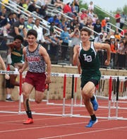 Milford's Carson Jensen and Lake Orion's Thomas Moreman sprint to the finish in their 110-meter hurdles during the Division 1 track and field state finals on Saturday, June 1, 2019, at East Kentwood.