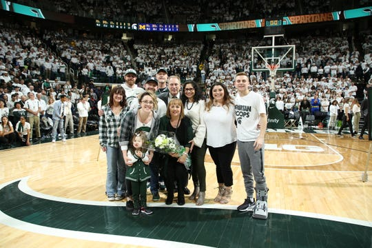 Lori Soderberg and her family with Tom Izzo and his family after the Spartans' senior night win over Michigan on March 9.